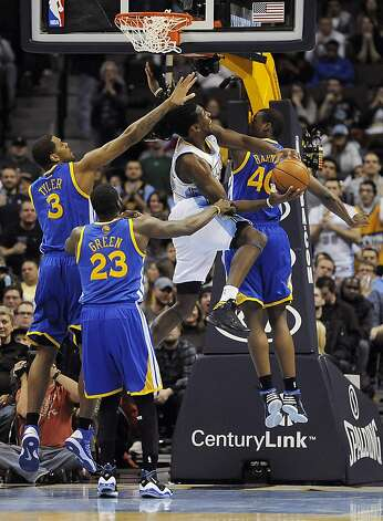 Denver Nuggets forward Kenneth Faried, center, puts up the ball over the defense of Golden State Warriors forward Jeremy Tyler, left, forward Draymond Green, bottom left, and forward Harrison Barnes, right, in the second half of an NBA basketball game on Sunday, Jan. 13, 2013, in Denver. The Nuggets won 116-105. (AP Photo/Chris Schneider) Photo: Chris Schneider, Associated Press