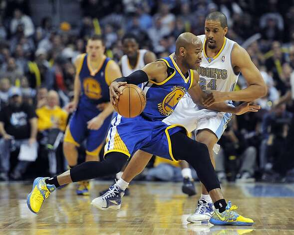 Golden State Warriors guard Jarrett Jack, left, tries to dribble past Denver Nuggets guard Andre Miller, right, in the second half of an NBA basketball game on Sunday, Jan. 13, 2013, in Denver. The Nuggets won 116-105. (AP Photo/Chris Schneider) Photo: Chris Schneider, Associated Press