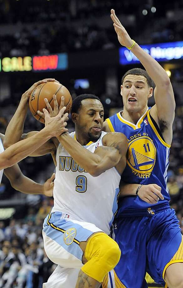 Denver Nuggets guard Andre Iguodala, left, drives past Golden State Warriors guard Klay Thompson, right, in the second half of an NBA basketball game on Sunday, Jan. 13, 2013, in Denver. The Nuggets won 116-105. (AP Photo/Chris Schneider) Photo: Chris Schneider, Associated Press