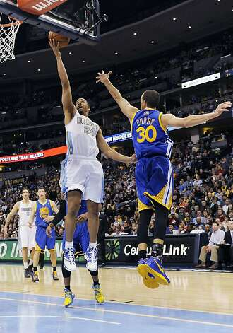 Denver Nuggets guard Andre Miller, left, drives past Golden State Warriors guard Stephen Curry in the second half of an NBA basketball game on Sunday, Jan. 13, 2013, in Denver. The Nuggets won 116-105. (AP Photo/Chris Schneider) Photo: Chris Schneider, Associated Press