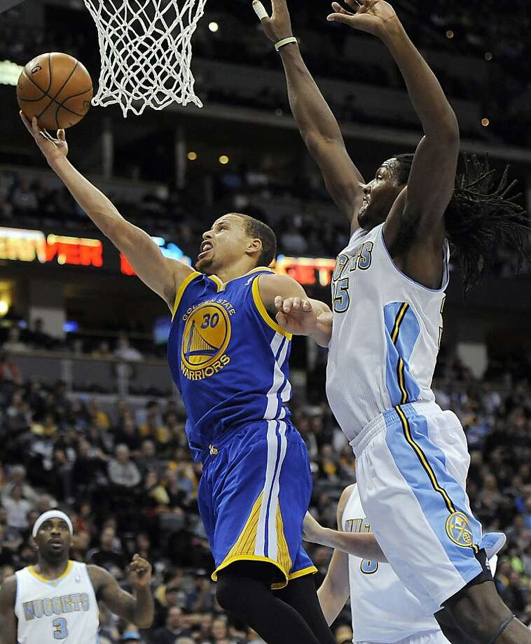 Golden State Warriors guard Stephen Curry, left, drives past Denver Nuggets forward Kenneth Faried, right, in the second half of an NBA basketball game on Sunday, Jan. 13, 2013, in Denver. The Nuggets won 116-105. (AP Photo/Chris Schneider) Photo: Chris Schneider, Associated Press