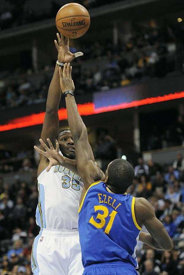 Denver Nuggets forward Kenneth Faried, left, shoots over Golden State Warriors center Festus Ezeli, right, in the second half of an NBA basketball game on Sunday, Jan. 13, 2013, in Denver. The Nuggets won 116-105. (AP Photo/Chris Schneider) Photo: Chris Schneider, Associated Press