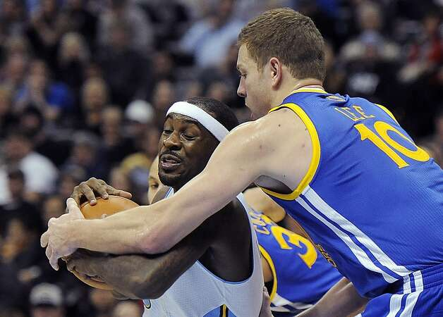 Denver Nuggets guard Ty Lawson, left, is defended by Golden State Warriors forward David Lee, right, in the second half of an NBA basketball game on Sunday, Jan. 13, 2013, in Denver. The Nuggets won 116-105. (AP Photo/Chris Schneider) Photo: Chris Schneider, Associated Press