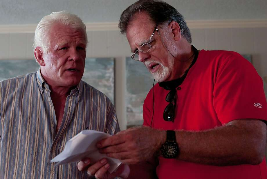 "Above, actor Nick Nolte (left) confers with Taylor Hackford on the set of ""Parker,"" the director's first genre film. Photo: FIlm District"