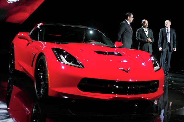 DETROIT, MI - JANUARY 13: Mark Reuss (L), General Motors' President of North America, Ed Welburn (C), Vice President of Global Design, and Tadge Juenter, Corvette Chief Engineer, stand with the 7th-generation Chevrolet Corvette, the C7, during its reveal to the media at the Russell Industrial Complex January 13, 2013 in Detroit, Michigan. The redesigned 2014 Corvette was revealed at a preview of the 2013 North American International Auto Show, which opens in Detroit January 14th. Photo: Bill Pugliano, Getty Images / 2013 Getty Images