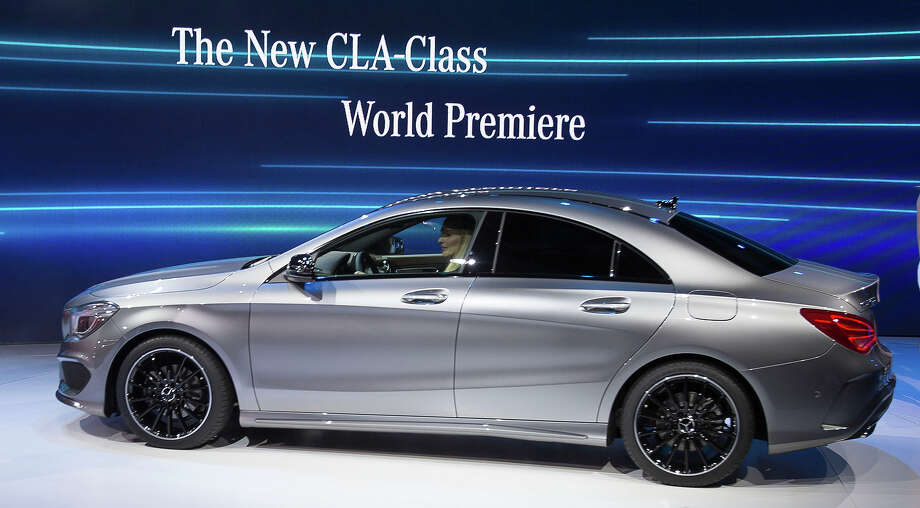 The Mercedes CLA class car is premiered at a press event  on the eve of the 2013 North American International Auto Show in Detroit, Michigan, January 13, 2013.   AFP PHOTO / Geoff ROBINS Photo: GEOFF ROBINS, AFP/Getty Images / 2013 AFP