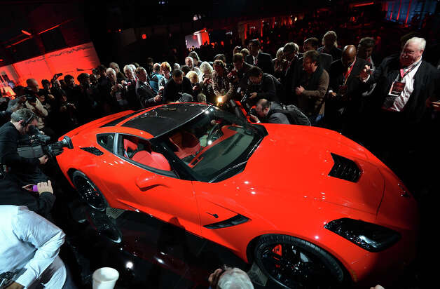 The redesigned 2014Chevrolet Corvette Stingray is introduced the night before press previews start at the 2013 North American International Auto Show in Detroit, Michigan, January 13, 2013. AFP PHOTO/Stan HONDA Photo: STAN HONDA, AFP/Getty Images / 2013 AFP