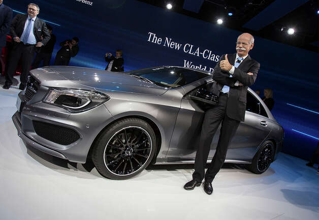 Mercedes Chairman of the Board Dr. Dieter Zetsche poses for a photo at the launch of the company's CLA class car on the eve of the 2013 North American International Auto Show in Detroit, Michigan, January 13, 2013.    AFP PHOTO / Geoff ROBINS Photo: GEOFF ROBINS, AFP/Getty Images / 2013 AFP