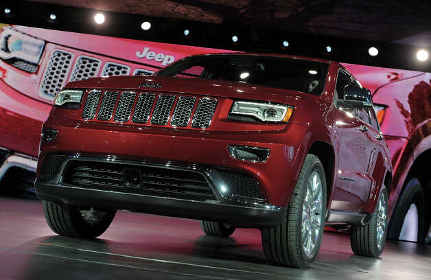 The 2013 Jeep Grand Cherokee revised design is introduced at the 2013 North American International Auto Show in Detroit, Michigan, January 14, 2013. AFP PHOTO/Stan HONDA Photo: STAN HONDA, AFP/Getty Images / 2013 AFP