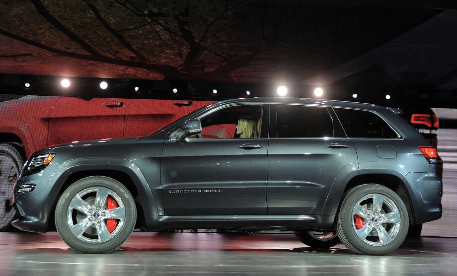 The 2014 Jeep Grand Cherokee SRT high performance version is introduced at the 2013 North American International Auto Show in Detroit, Michigan, January 14, 2013. AFP PHOTO/Stan HONDA Photo: STAN HONDA, AFP/Getty Images / 2013 AFP
