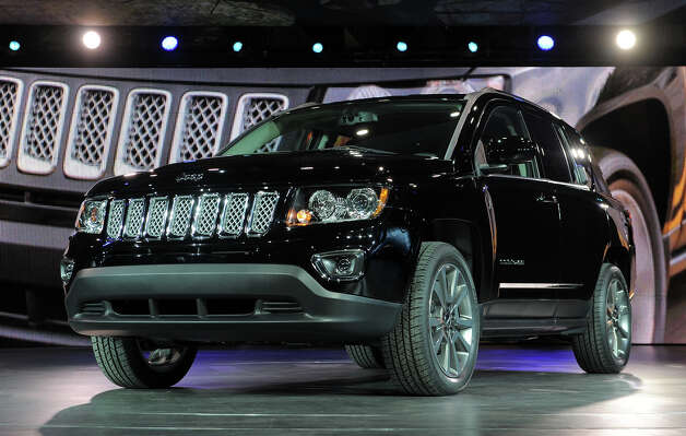 The 2014 Jeep Compass is introduced at the 2013 North American International Auto Show in Detroit, Michigan, January 14, 2013. AFP PHOTO/Stan HONDA Photo: STAN HONDA, AFP/Getty Images / 2013 AFP