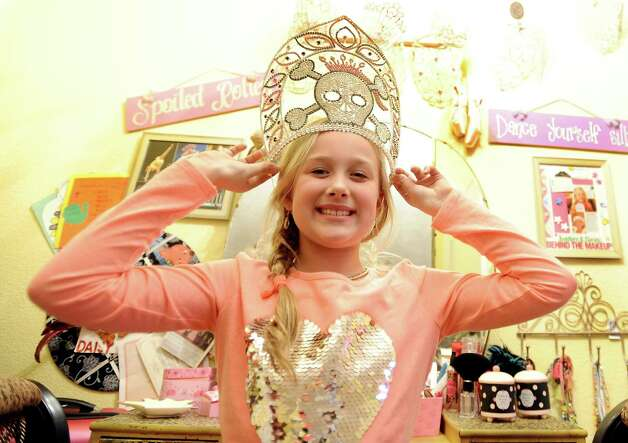 Bridge City resident Daisy Cutchins shows off one of her many prized tiaras on Friday, January 11, 2013.  Cutchins will be appearing on the Toddlers and Tiaras episode this Wednesday, January 16, 2013.  Cutchins has been competing in pageants and shows for some time now and has the awards to prove it.   Photo taken: Randy Edwards/The Enterprise Photo: Randy Edwards