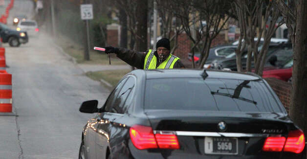 Bexar County Precinct 4 Deputy Constable J.L. Guerrero directs traffic Monday morning January 14, 2013 at the intersection of Broadway and Hildebrand. An 18-month drainage project in the area makes Hildebrand Avenue a one-way street between the San Antonio River and North New Braunfels Avenue. Guerrero said the so far things were running smoothly and most drivers were aware of the changes in traffic patterns. Photo: JOHN DAVENPORT, San Antonio Express-News / ©San Antonio Express-News/ Photo may be sold to the public