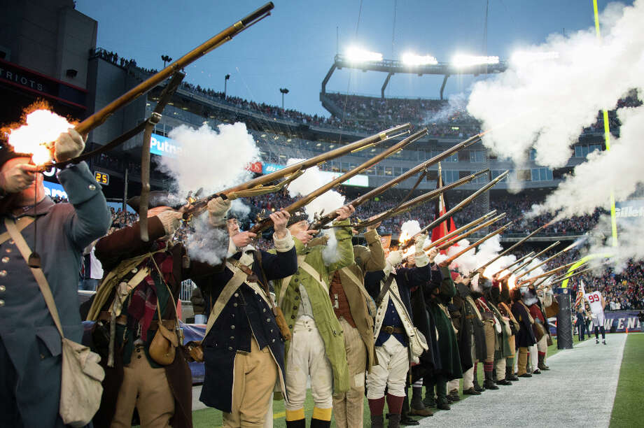 Patriot reenactors fire muskets before the game. Photo: Smiley N. Pool, Houston Chronicle / © 2013  Houston Chronicle