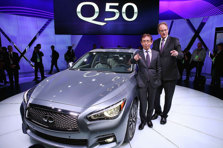 DETROIT, MI - JANUARY 14: Johan De Nysschen (R) president of Infiniti Motor Corp. and Shiro Nakamura chief creative offcer,  introduce the 2014 Q50 to replace their best-selling G sedan at the North American International Auto Show on January 14, 2013 in Detroit, Michigan. The auto show will be open to the public January 19-27. Photo: Scott Olson, Getty Images / 2013 Getty Images