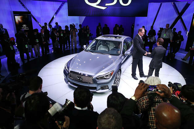 DETROIT, MI - JANUARY 14:  Johan De Nysschen (L) president of Infiniti Motor Corp. and Shiro Nakamura chief creative offcer,  introduce the 2014 Q50 to replace their best-selling G sedan at the North American International Auto Show on January 14, 2013 in Detroit, Michigan. The auto show will be open to the public January 19-27. Photo: Scott Olson, Getty Images / 2013 Getty Images