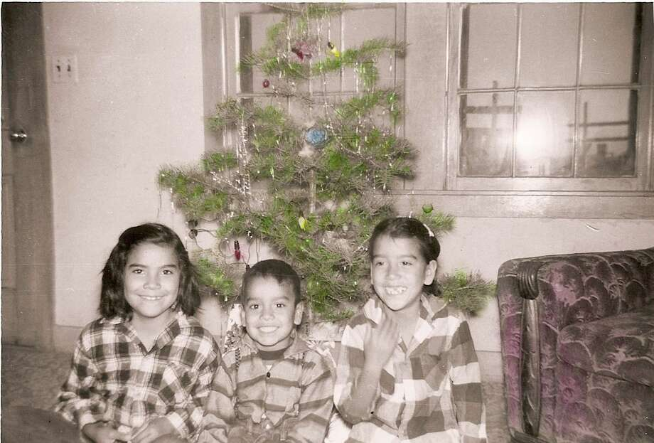Then: From left, siblings Maria, Juan and Celia Aguilera, Dec. 23, 1957 in Muleshoe, Tex. Photo: Aguilera, Reader Submission