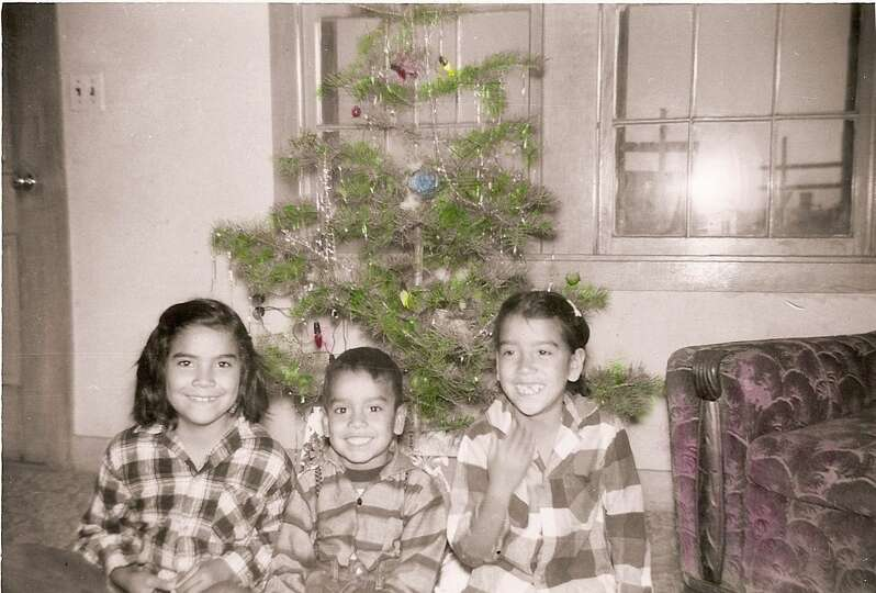 Then: From left, siblings Maria, Juan and Celia Aguilera, Dec. 23, 1957 in Muleshoe, Tex.