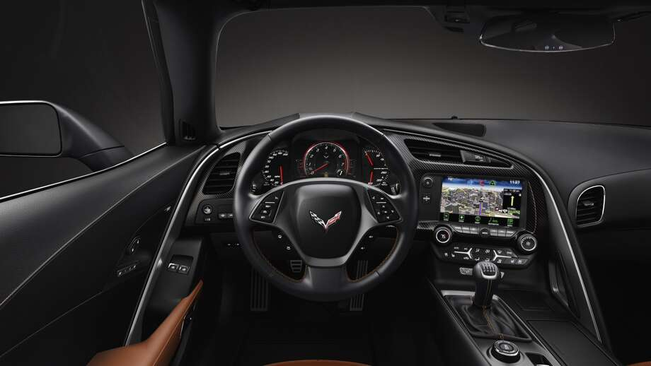 Going digital: GM has ditched standard dials and a manual parking brake for an all-digital package. The digital display will free up some space inside the car and give drivers a bit more control.Read moreabout the new C7 Corvette. Photo: General Motors,  Alan Vanderkaay