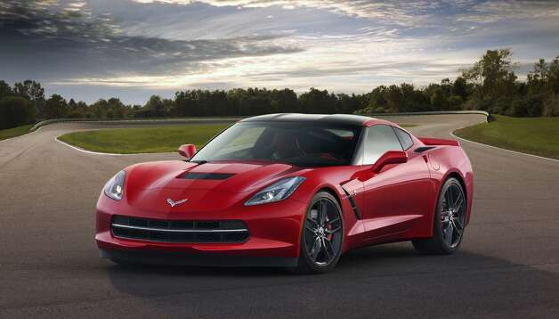 CHEVROLET CORVETTE: The 2014 model is the first all-new version of the iconic sports car in nine years. It has a dramatic styling that picks up cues from the 1963 Sting Ray and newer Corvettes. GM promised it would perform better than the current model yet will get better gas mileage. The two-seater arrives at showrooms in the fall. A 6.2-liter small-block V-8 with 450 horsepower takes the car from zero to 60 mph in under four seconds.More photos of the new Corvette Photo: General Motors