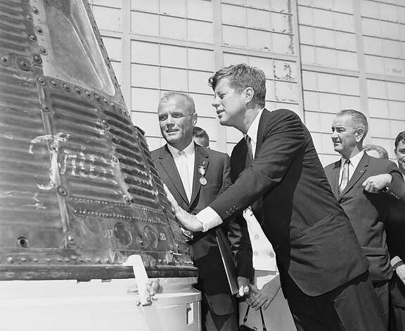 John Glenn and President John F. Kennedy inspect the capsule which the astronaut rode in orbit. Photo: Anonymous, Associated Press