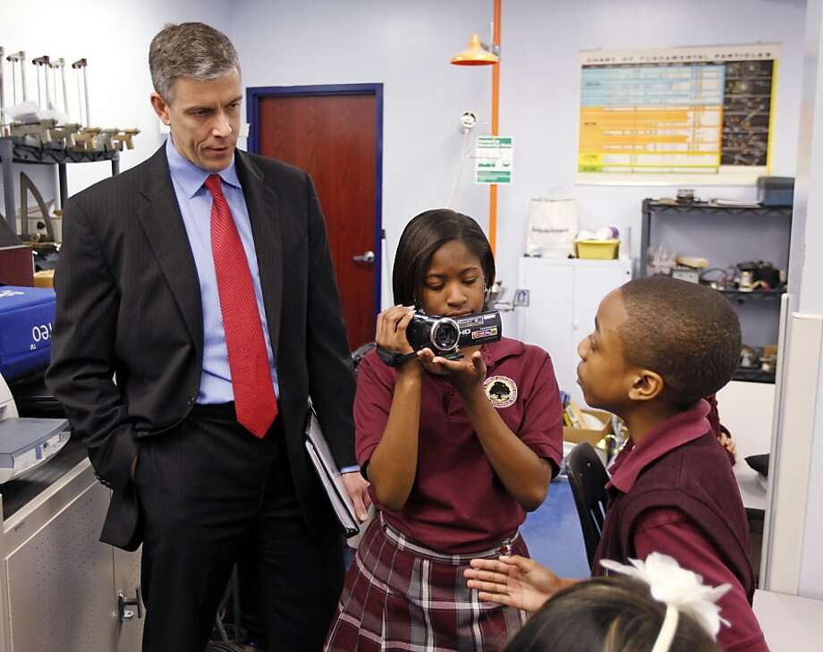 Education Secretary Arne Duncan, in Indianapolis with students, sees value in a longer school year. Photo: Michael Conroy, Associated Press