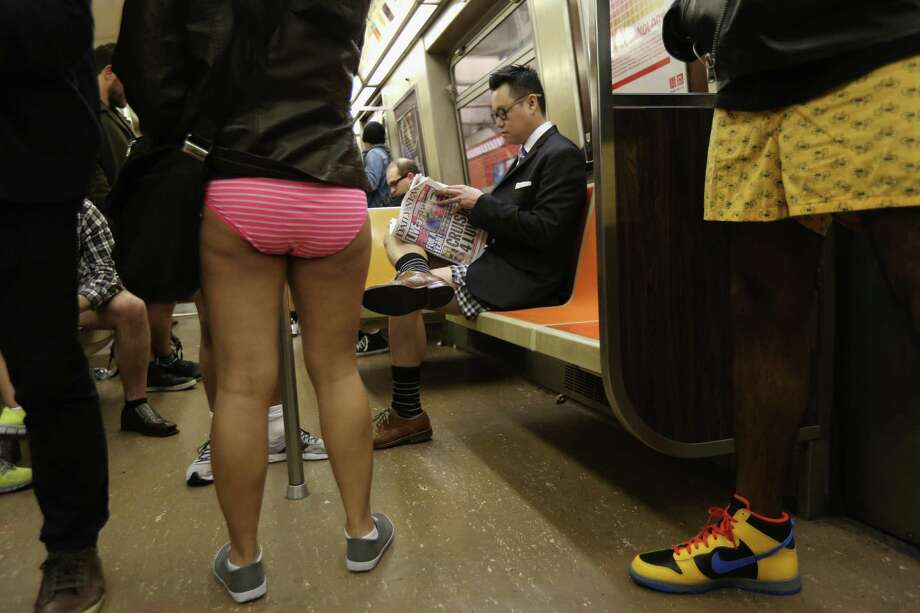 "NEW YORK, NY - JANUARY 13:  People ride the subway pantless on January 13, 2013 in New York City. Thousands of people participated in the 12th annual No Pants Subway Ride, organized by New York City prank collective Improv Everywhere. During the afternoon winter event, participants boarded separate subway stops and removed their pants, pretending that they did not know each other. The event, refered to as a ""celebration of silliness"" is designed to make fellow subway riders laugh and smile. Photo: John Moore, Getty Images / 2013 Getty Images"