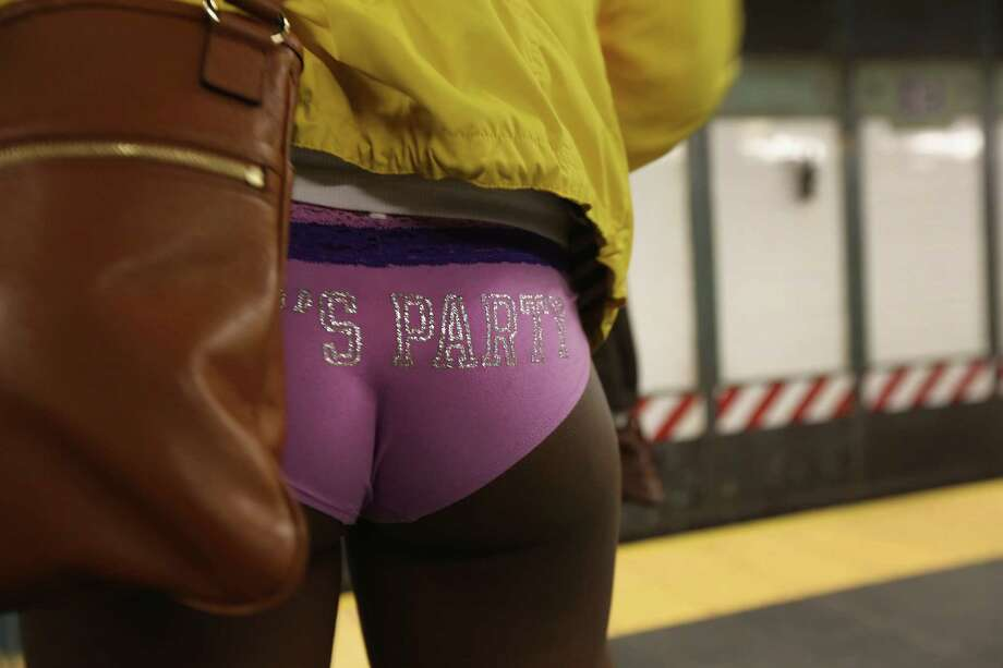 """NEW YORK, NY - JANUARY 13:  A pantless woman stands on a subway platform on January 13, 2013 in New York City. Thousands of people participated in the 12th annual No Pants Subway Ride, organized by New York City prank collective Improv Everywhere. During the afternoon winter event, participants boarded separate subway stops and removed their pants, pretending that they did not know each other. The event, refered to as a """"celebration of silliness"""" is designed to make fellow subway riders laugh and smile. Photo: John Moore, Getty Images / 2013 Getty Images"""