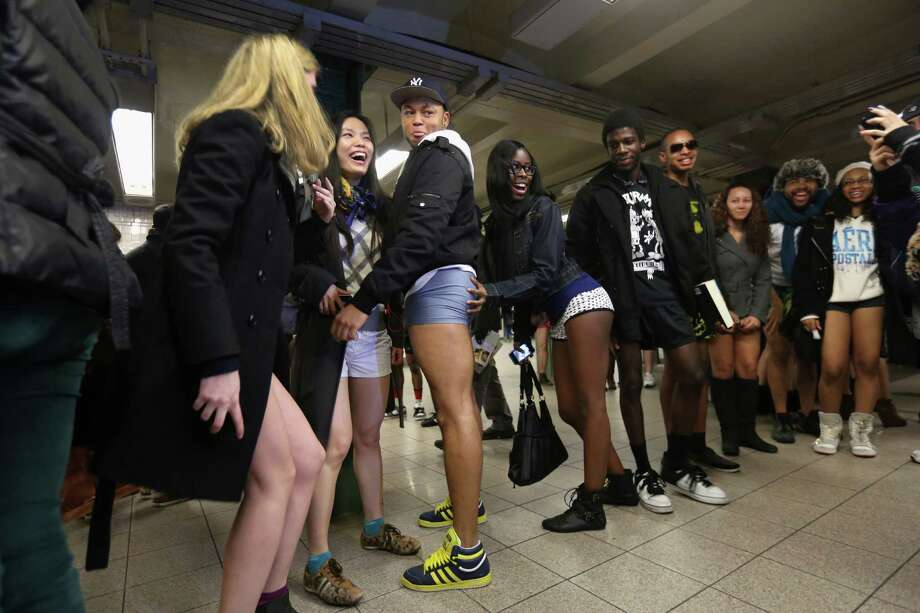 "NEW YORK, NY - JANUARY 13:  Pantless people pose for photos at the Union Square subway station on January 13, 2013 in New York City. Thousands of people participated in the 12th annual No Pants Subway Ride, organized by New York City prank collective Improv Everywhere. During the afternoon winter event, participants boarded separate subway stops and removed their pants, pretending that they did not know each other. The event, refered to as a ""celebration of silliness"" is designed to make fellow subway riders laugh and smile. Photo: John Moore, Getty Images / 2013 Getty Images"