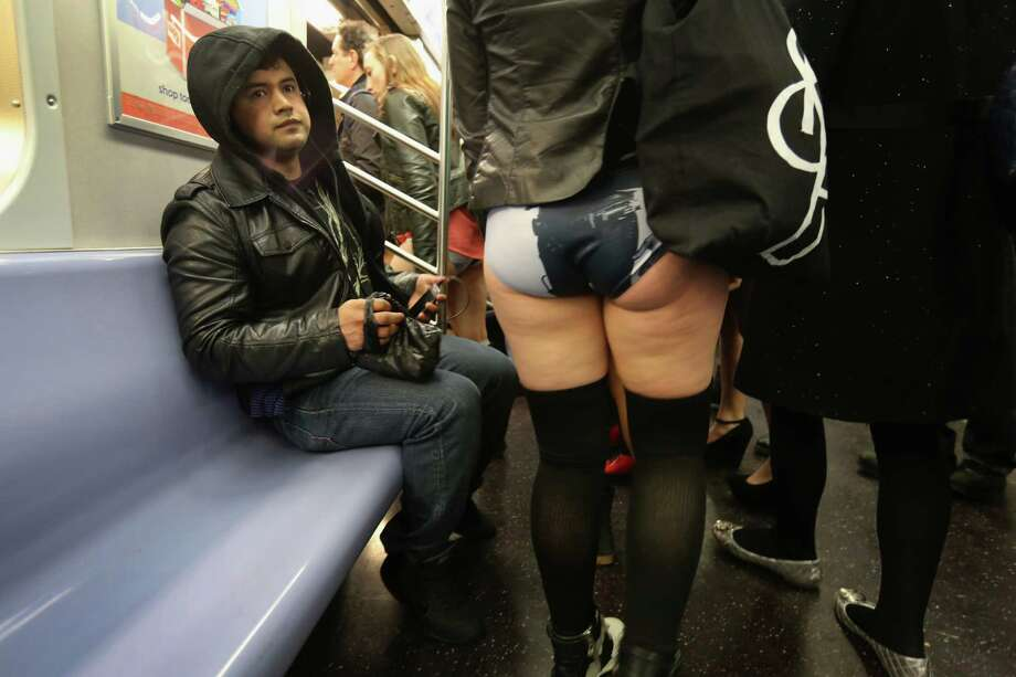 "NEW YORK, NY - JANUARY 13:  A woman rides the subway pantless on January 13, 2013 in New York City. Thousands of people participated in the 12th annual No Pants Subway Ride, organized by New York City prank collective Improv Everywhere. During the afternoon winter event, participants boarded separate subway stops and removed their pants, pretending that they did not know each other. The event, refered to as a ""celebration of silliness"" is designed to make fellow subway riders laugh and smile. Photo: John Moore, Getty Images / 2013 Getty Images"