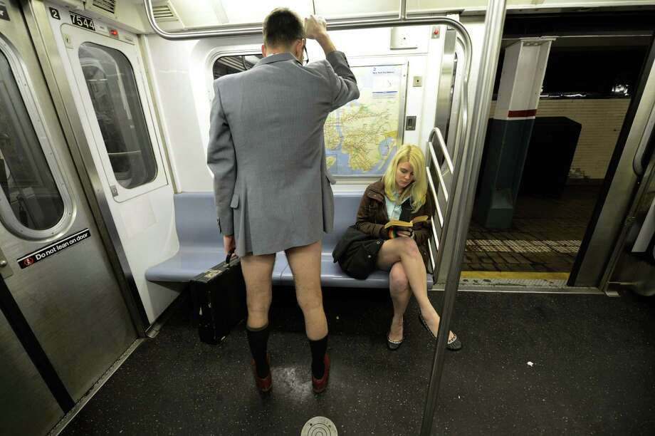 Some riders in the New York City subway in the underwear as the take part in the 2013 No Pants Subway Ride January 13, 2013. Started by Improv Everywhere, the goal is for riders to get on the subway train dressed in normal winter clothes (without pants) and keep a straight face.  AFP PHOTO / TIMOTHY A. CLARYTIMOTHY A. CLARY/AFP/Getty Images Photo: TIMOTHY A. CLARY, AFP/Getty Images / AFP
