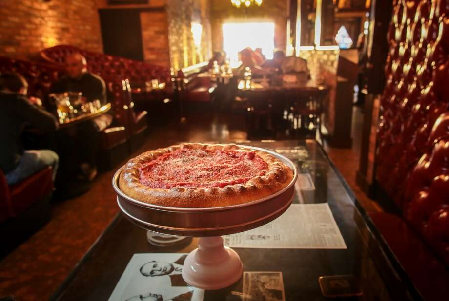 We also ordered the stuffed Sam Giancana ($27), where golden crust surrounded mozzarella, provolone, Romano, house-made honey Calabrese sausage and Chicago Italian sausage, with a thick spread of sweet tomato sauce with oregano and garlic on top.