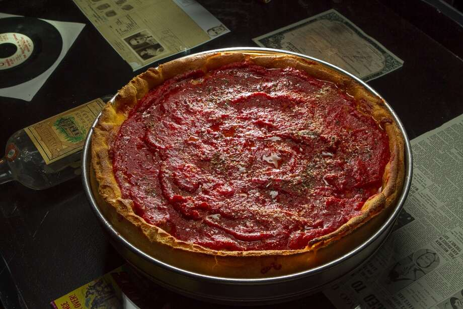 Then there was deep-dish Michigan Avenue pizza ($21) with a thick cornmeal crust topped with pepperoni, a thick layer of cheese and a thick pool of sauce. It takes 40 minutes to prepare, and one slice is like a belly bomb. How can you eat more? Some people do, but it's pretty good the next day too.