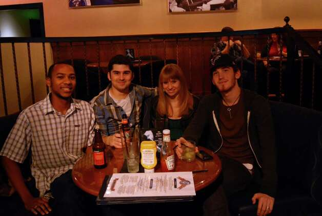 Friends Trevon Carter (from left) Zack Kieslich (cq), Stephanie Miles and Corbin Miles enjoy the night at the Angry Elephant on January 9, 2013. Robin Johnson Photo: Robin Johnson
