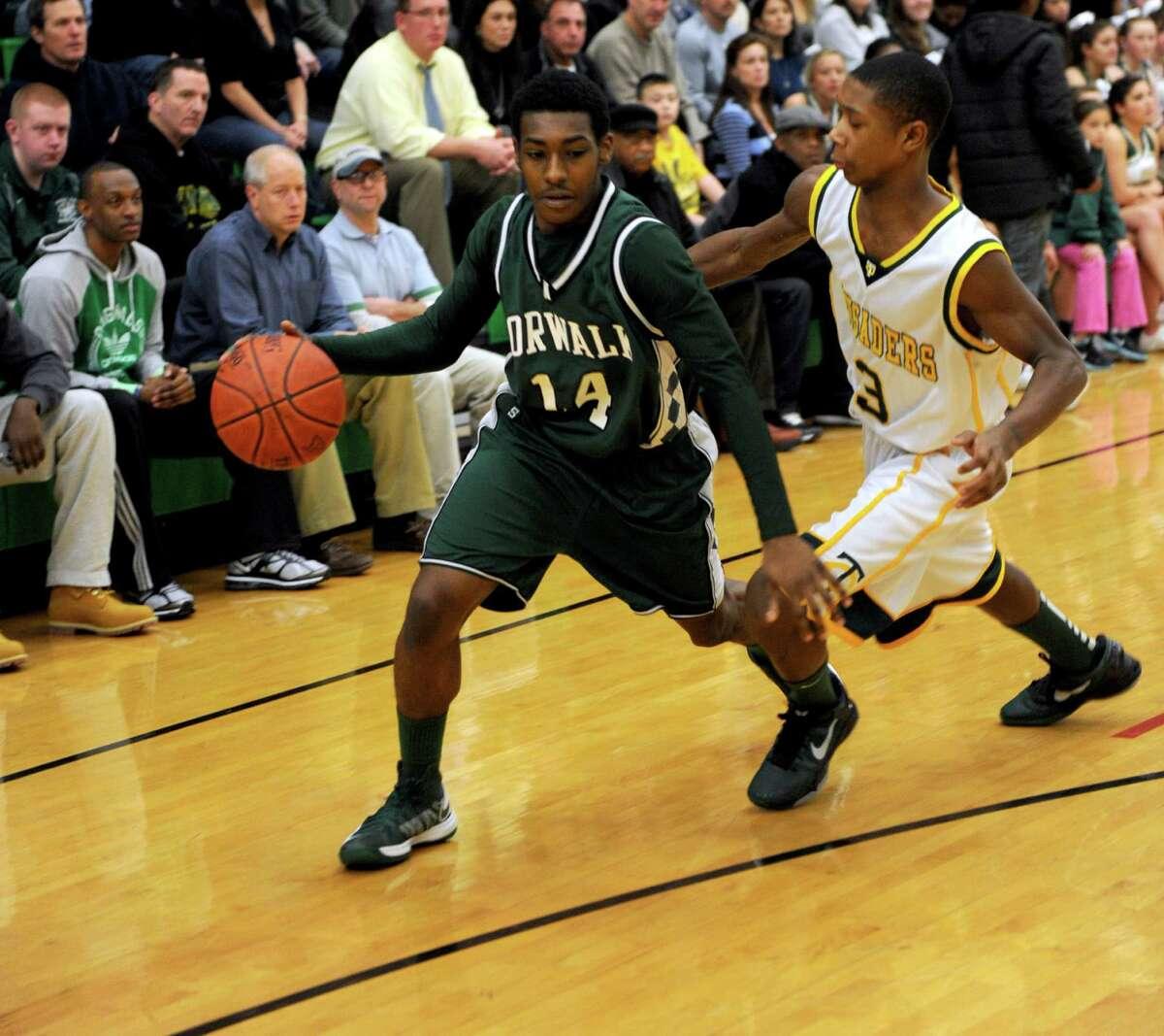 Norwalk's Jabari Dear controls the ball during Friday's boys basketball game at Trinity Catholic High School in Stamford on December 21, 2012.
