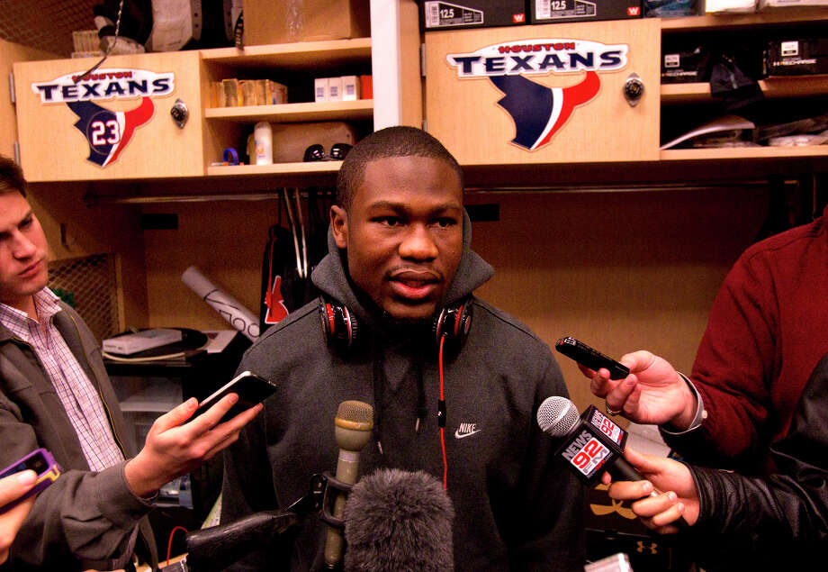 Justin Forsett is interviewed in front of his locker. Photo: Cody Duty, Houston Chronicle / © 2012 Houston Chronicle