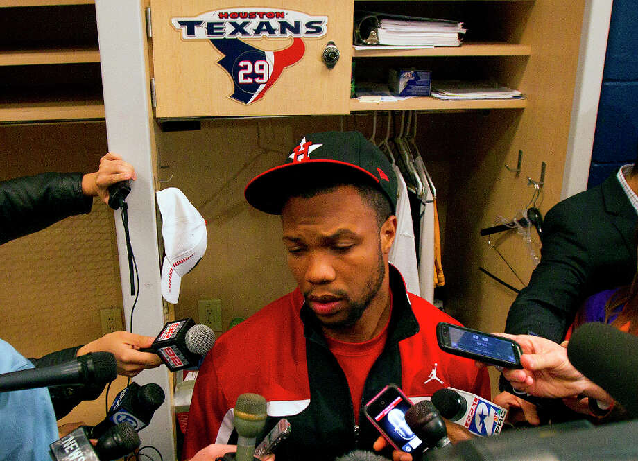Glover Quin is interviewed in front of his locker. Photo: Cody Duty, Houston Chronicle / © 2012 Houston Chronicle