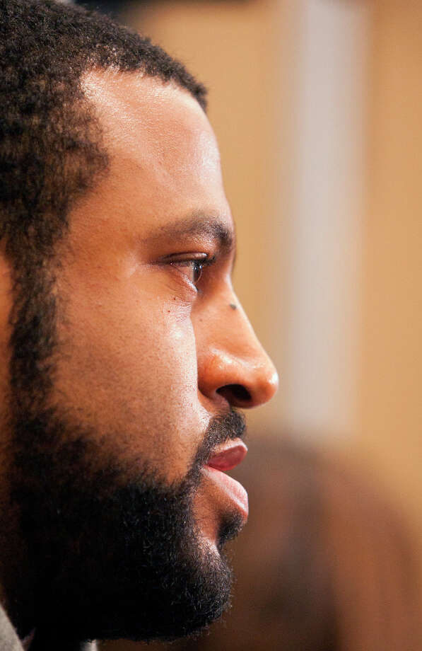 Duane Brown is interviewed in front of his locker. Photo: Cody Duty, Houston Chronicle / © 2012 Houston Chronicle