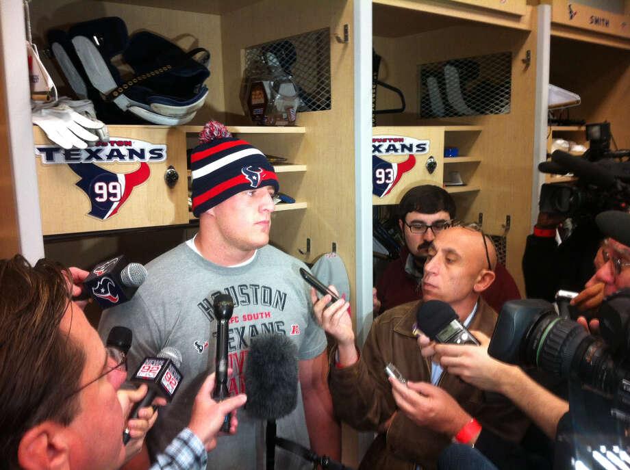 J.J. Watt is interviewed in front of his locker.