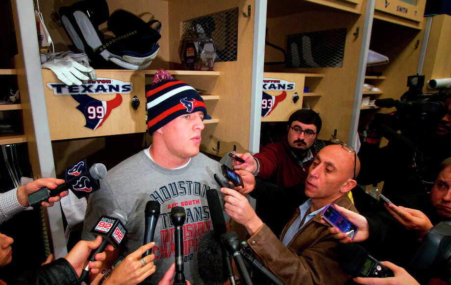 J.J. Watt is interviewed in front of his locker. Photo: Cody Duty, Houston Chronicle / © 2012 Houston Chronicle