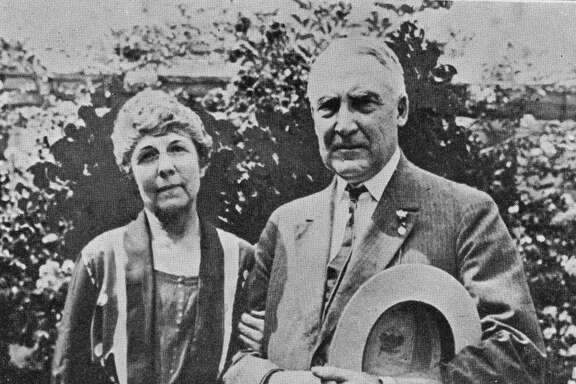The 29th American President Warren Gamaliel Harding (1865 - 1923) and his wife Florence Kling DeWolfe. Below them is a quote reading 'I must forget their eminence and regard them as two regular human beings'. (Photo by Hulton Archive/Getty Images)