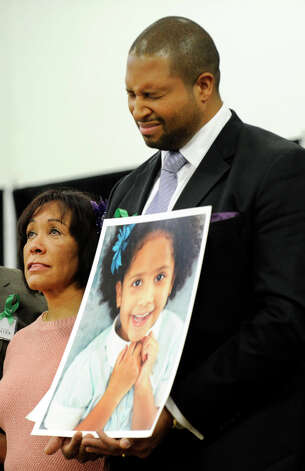 Jimmy Greene, father of Ana, one of the children killed in the Sandy Hook Elementary School shootings, holds his daughter's photograph at a press conference Monday morning for Sandy Hook Promise, a grassroots initiative to end gun violence. Photo: Carol Kaliff / The News-Times