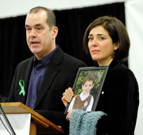 David and Francine Wheeler, parents of Ben, one of the victims of the Sandy Hook Elementary School shootings, addresses a press conference Monday morning annoucing a grassroots initiative to end gun violence called Sandy Hook Promise. The meeting was held at the Edmond Town Hall, Monday, January 14, 2013. Photo: Carol Kaliff / The News-Times