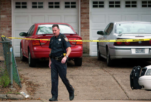 The Harris County Sheriff's Department investigates a shooting that took place in the 5000 block of Sandydale Lane, Monday, Jan. 14, 2013, in Houston. Cody Duty / Houston Chronicle) Photo: Cody Duty, Houston Chronicle / © 2012 Houston Chronicle