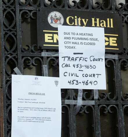 Signs on the front door of City Hall announcing the temporary closing Jan. 14, 2013 in Albany, N.Y  due to a water problem in the basement.    (Skip Dickstein/Times Union) Photo: SKIP DICKSTEIN