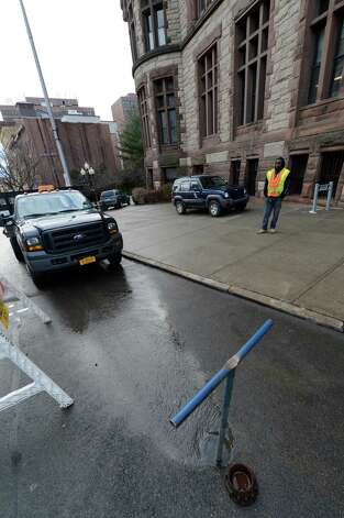 Water spouts from the street on Pine Street next to City Hall which was one of the causes for the temporary closing of City Hall Jan. 14, 2013 in Albany, N.Y      (Skip Dickstein/Times Union) Photo: SKIP DICKSTEIN