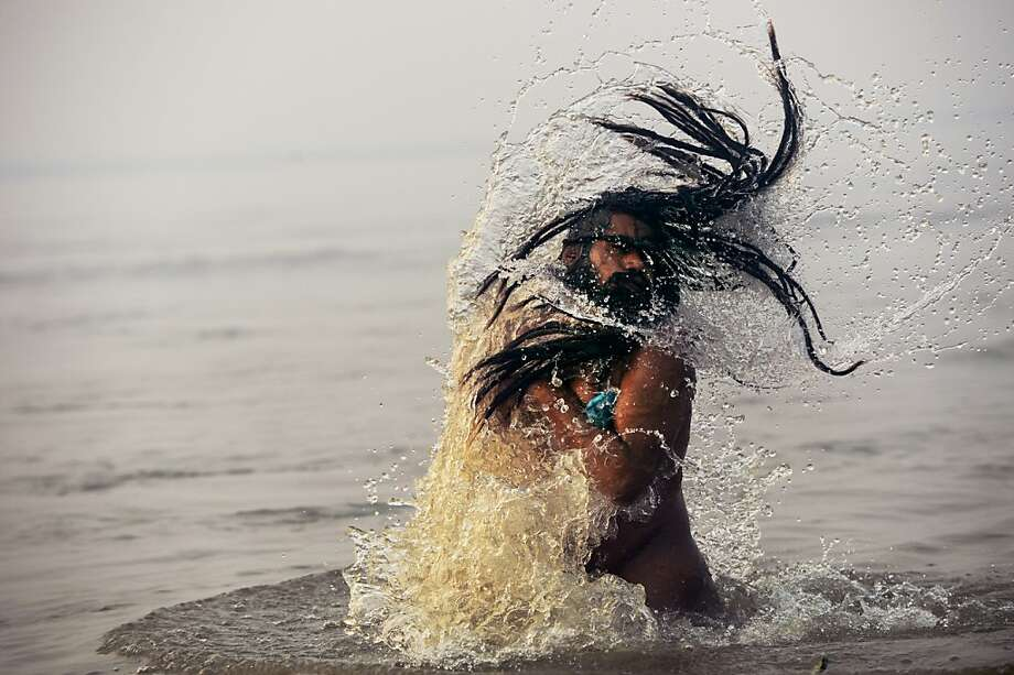 To cleanse his spirit of sin, a sadhu dips in the holy confluence of the Yamuna and Ganges, ironically two of the most polluted rivers in the world, during the Kumbh Mela in Allahabad, India. Photo: Roberto Schmidt, AFP/Getty Images