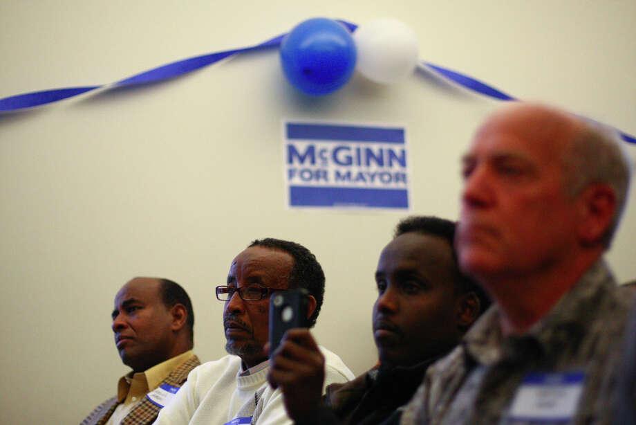 People listen as Seattle Mayor Mike McGinn announces he will seek a second term. Photo: JOSHUA TRUJILLO / SEATTLEPI.COM