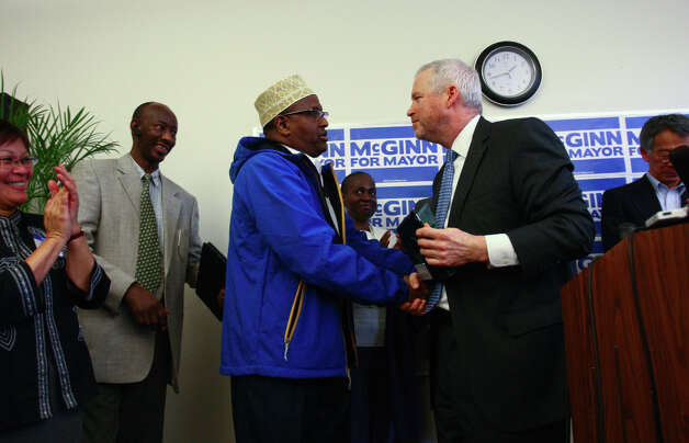 Mayor Mike McGinn announces for reelection, greeting immigrant and refugee representative Mohammed Sheik Hassan.  He is making police reform a centerpiece of his re-election campaign, and trying to push Seattle City Attorney Pete Holmes out of the process. Photo: JOSHUA TRUJILLO / SEATTLEPI.COM