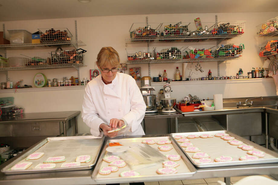 Susan Simms , of Westport, prepares an order of cookies for a birthday in New Jersey. Simms runs her cookie baking business, Susan's Cookie Stop , from a renovated garage on her property. Photo: BK Angeletti, B.K. Angeletti / Connecticut Post freelance B.K. Angeletti